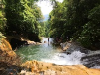 Rock sliding after a trek through the jungle